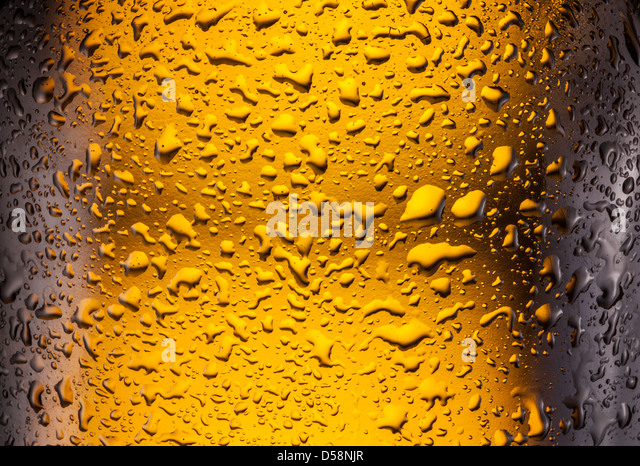 Сlose shot of drops on a bottle beer. - Stock Image
