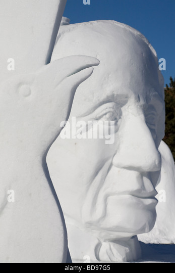 The raven and Sir John A. Macdonald snow sculptures. A softly focused, huge bust of Canada's first prime minister - Stock Image