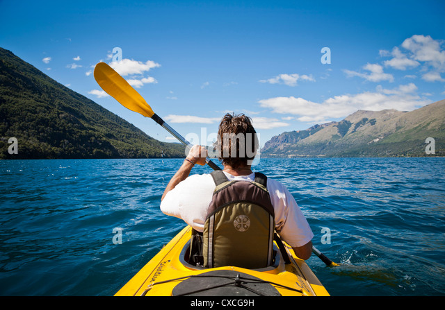 Kayakying at Guttierez lake in Estancia Peuma Hue, Lakes district, Patagonia, Argentina. - Stock-Bilder