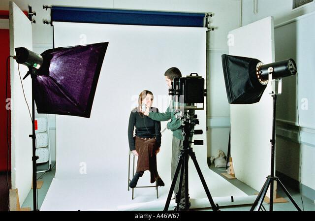 Photographer in studio - Stock Image