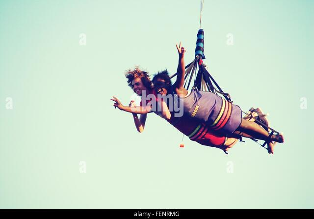 Low Angle View Of Couple Hang Gliding - Stock Image