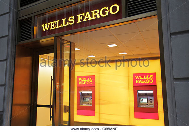 Lower Manhattan New York City NYC NY Financial District FiDi Broadway Wells Fargo Bank lobby entrance ATM machines - Stock Image