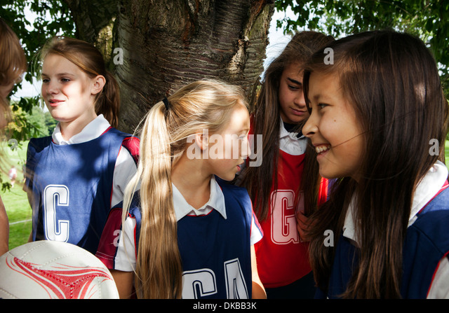 Teenage schoolgirl netball team in break - Stock Image