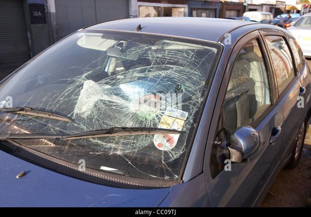 impact damage of a vehicle person crash on a car windscreen vehicle London England UK United kingdom - Stock Image
