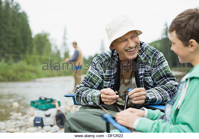 Grandfather and grandson getting ready to do some fishing - Stock Image