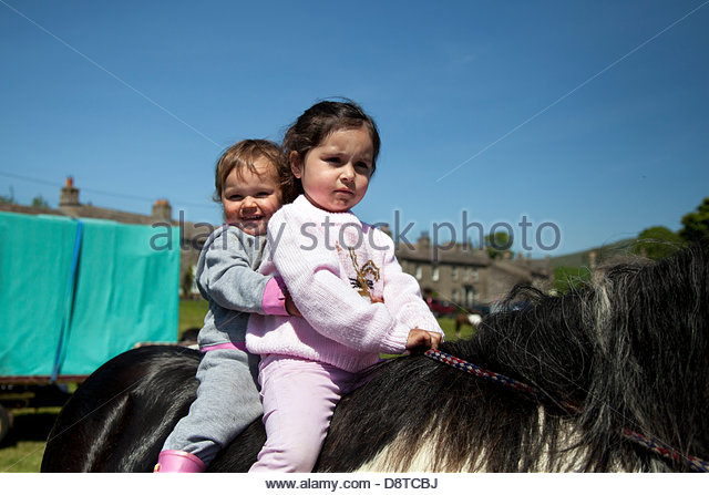 Bainbridge, Richmondshire, North Yorkshire, UK. 4th June, 2013. Imogen & Lily Corrie riding a Cob Horse with - Stock Image
