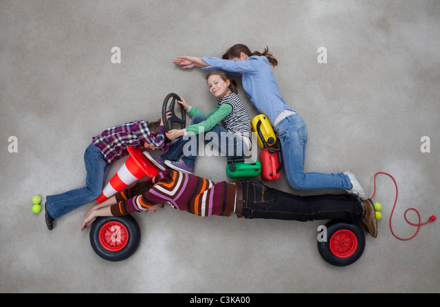 People together forming the shape of car - Stock Image
