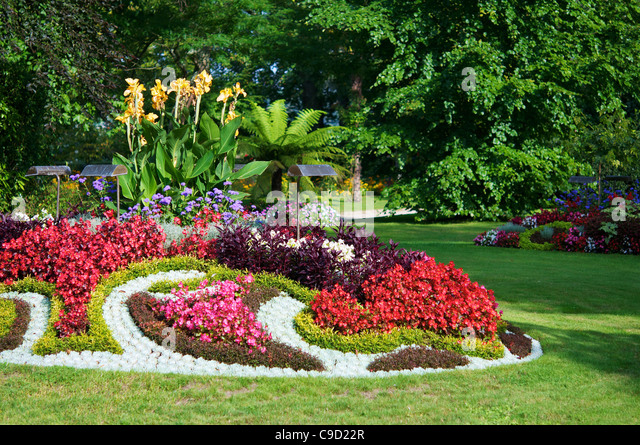 Colorful flower beds at the botanical garden of Coutances. - Stock Image