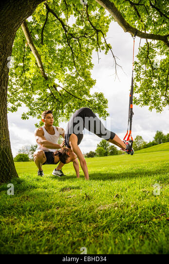 Personal trainers doing outdoor training in urban place, Munich, Bavaria, Germany - Stock-Bilder
