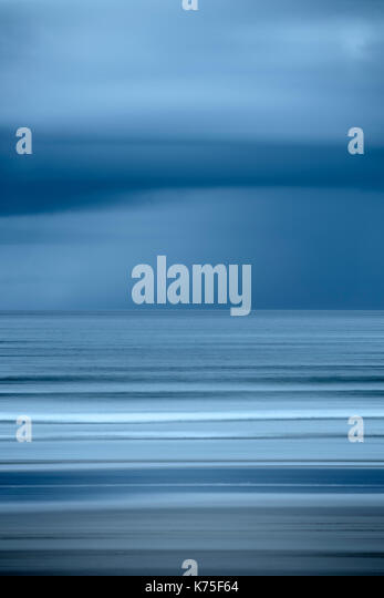 Abstract of  sea and sky blurred by intentional camera movement - Stock Image