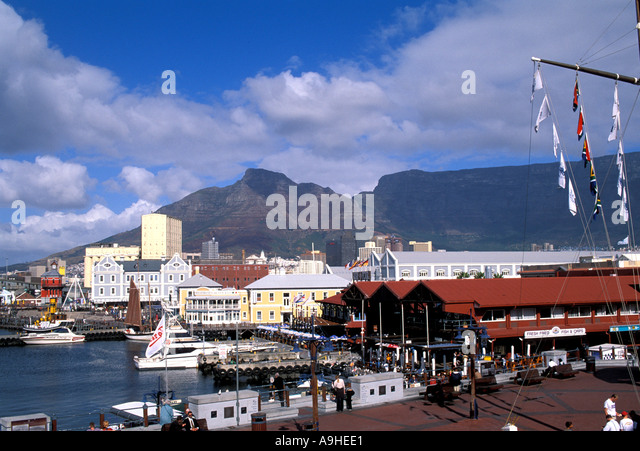 South Africa Cape Town Victoria Alfred Waterfront shopping arcade Table Mountain in background - Stock Image
