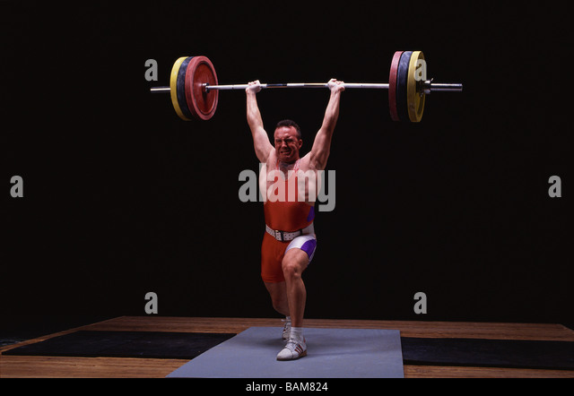 Olympic style weightlifter in action - Stock Image