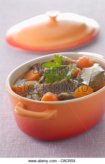 Beef and carrot stew in a casserole dish - Stock Image