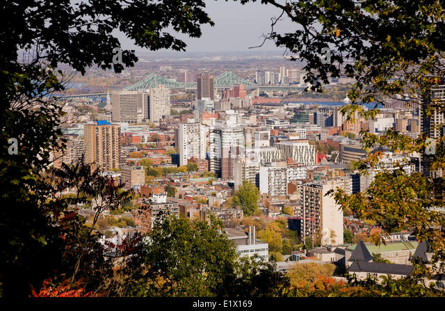 Montreal skyline and Jacques Cartier bridge taken from the lookout on Mount Royal Park in autumn, Montreal, Quebec, - Stock Image