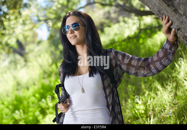 Mid adult woman out walking in forest - Stock Image
