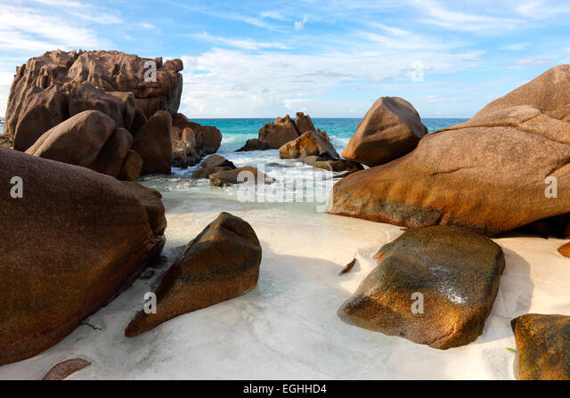 Seychelles rocks on the beach, La Digue. - Stock Image
