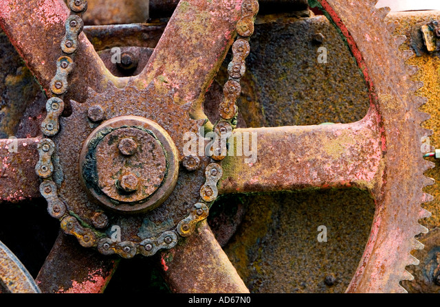 Old corroded chain driven farm machinery - Stock Image