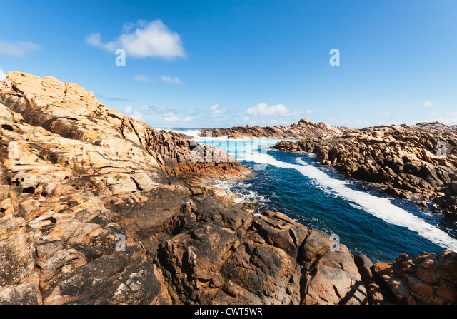 In yallingup, A series of rocks jut into the ocean creating a natural canal hollowed out by the force of the sea. - Stock Image