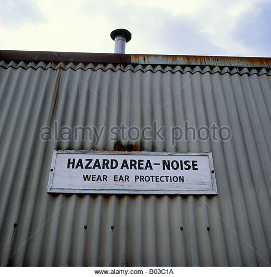 Noise hazard warning at industrial unit - Stock Image