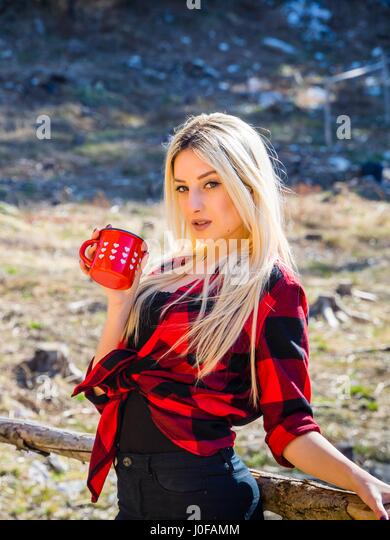 Attractive young woman blonde hair - Stock Image
