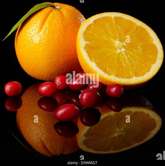 Orange on black - Stock Image