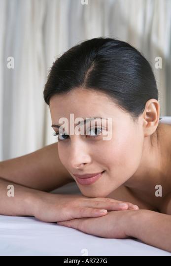 Woman lying on massage table - Stock-Bilder