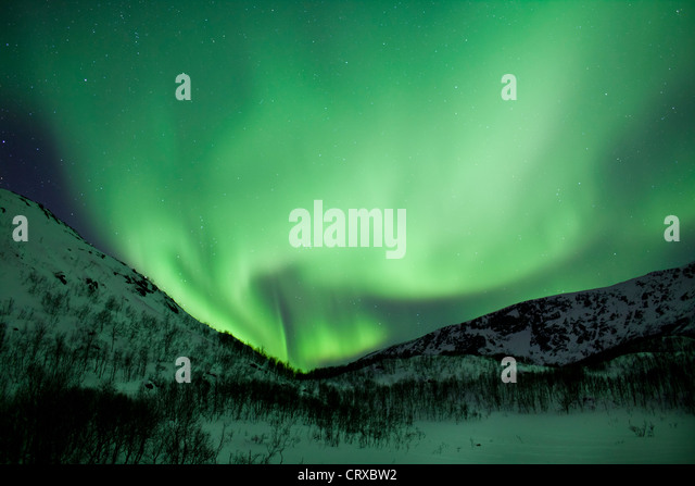 Aurora Borealis The Northern Lights fill the sky at Kvaloya in the Arctic Circle near Tromso, Northern Norway - Stock-Bilder