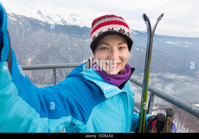 Female skier taking selfie. - Stock Image