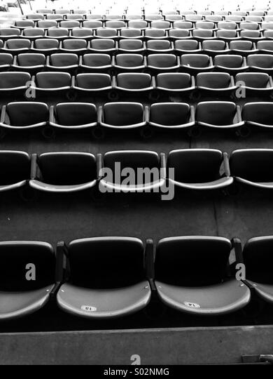 Rows of seats at a sports stadium - Stock Image