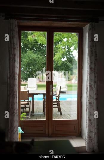 Patio doors garden stock photos patio doors garden stock for Looking for french doors