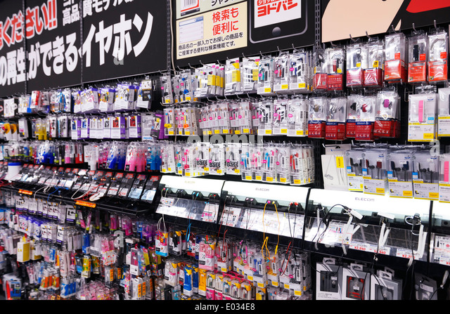 Cellphone accessories and earphones at electronics store Yodobashi Camera, Tokyo, Japan. - Stock Image