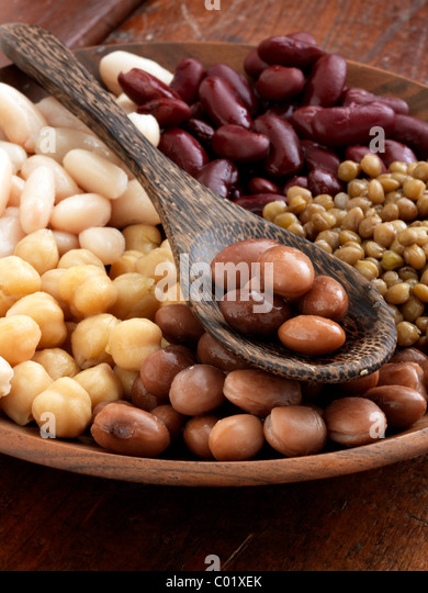 A bowl of beans red kidney lentils butter beans borlotti chick peas garbanzo beans - Stock Image
