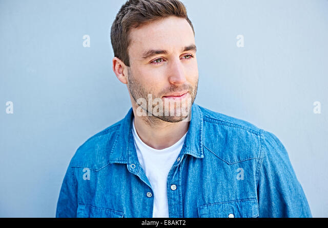 Close up of man in denim shirt - Stock Image