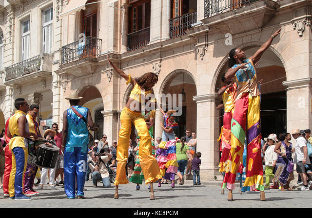 HAVANA, CUBA, FEBRUARY 16, 2014 : Stilt dancers in the streets of Havana. Havana is the largest city in the Caribbean - Stock Image