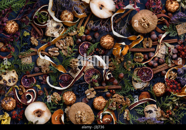 Thanksgiving decorationbackground, pastry, spices and nuts on rustic wooden table. Top view. - Stock Image