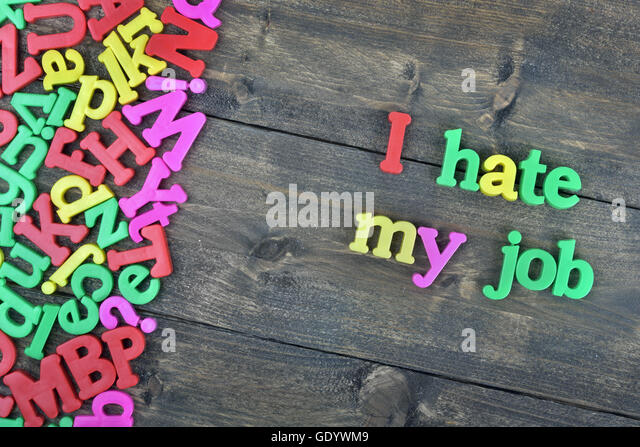 I hate my job word on wooden table - Stock Image