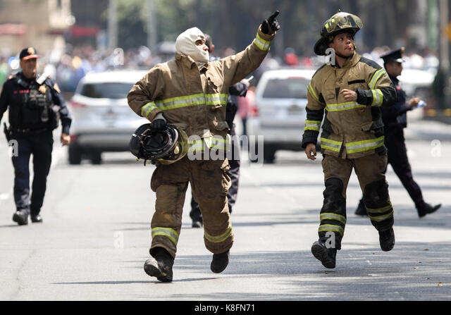 Mexico City, Mexico. 19th Sep, 2017. Firemen work after an earthquake in Mexico City, capital of Mexico, on Sept. - Stock Image