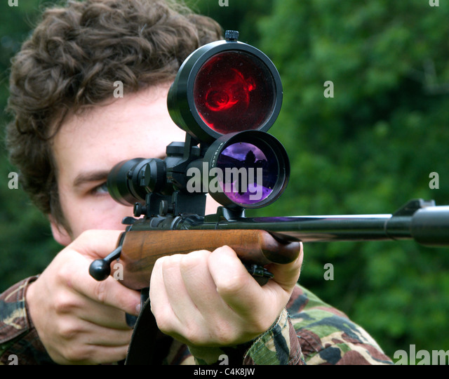 .22 rifle 22calibre caliber sporting rifle BRNO POSED BY MODEL - FULLY RELEASED -  with telescopic sight and night - Stock Image