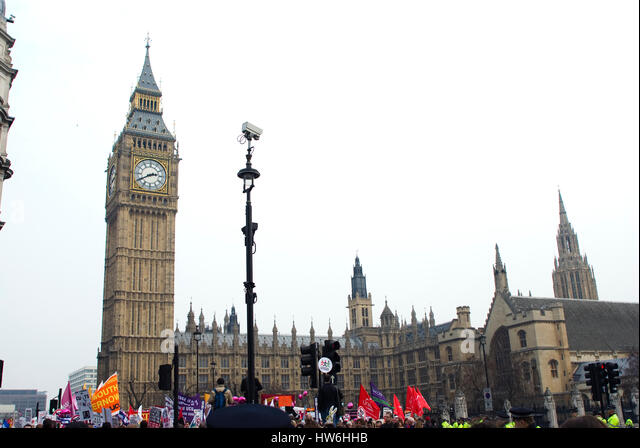 Placards being carried as part of a political protest on Parliament square in front of Big Ben and the Houses of - Stock Image