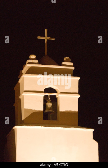 Chile San Pedro de Atacama cathedral steeple and cross at night - Stock Image