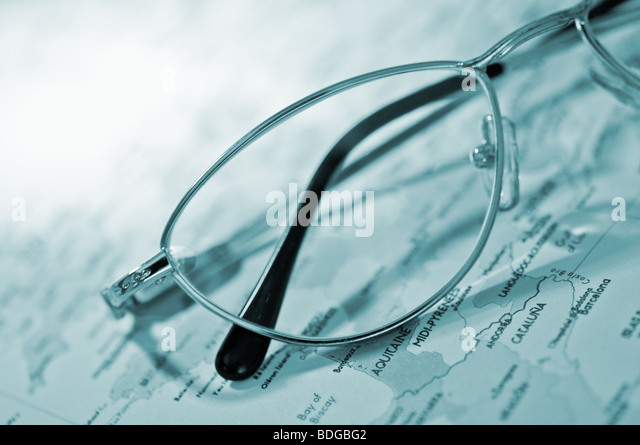 map and glasses closeup - Stock Image