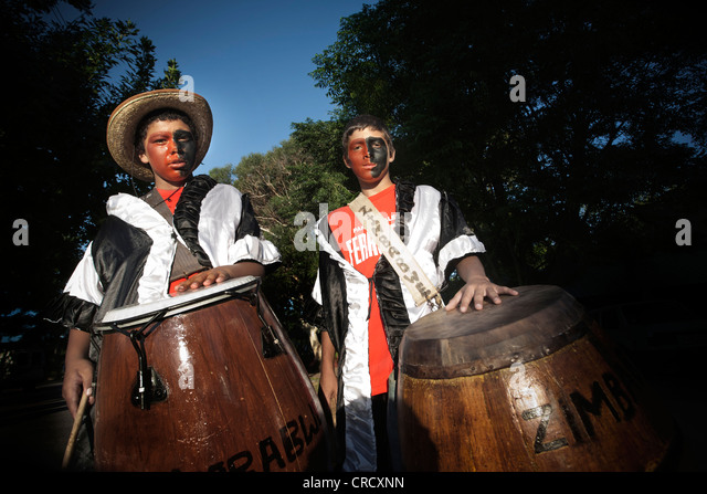 Two kids with drums at Colonia del Sacramento, Uruguay. - Stock Image