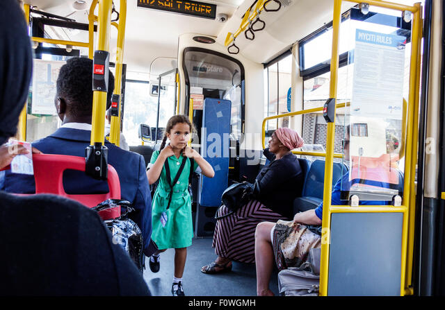 Cape Town South Africa African MyCiTi bus public transportation girl student school uniform riding home - Stock Image