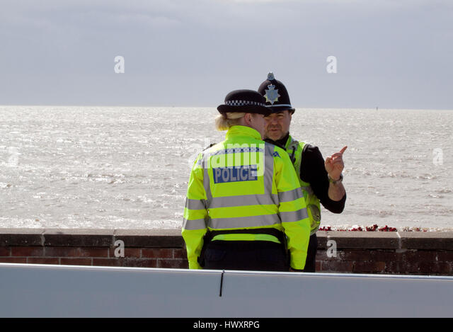 Two police officers patrolling on Felixstowe's sea front - Stock Image