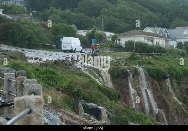 Coverack, Cornwall. 18th July 2017. Water flows from main road in Coverack Flash flood in coastal village of Coverack, - Stock Image