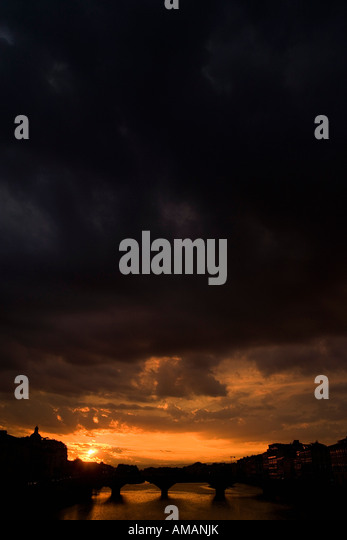Moody sky at sunset over Florence - Stock Image