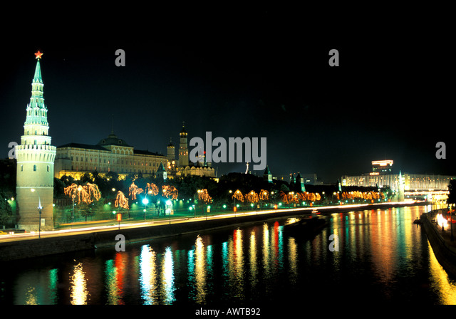 Moscow Russia Kremlin at Night Beside Moscow River - Stock Image