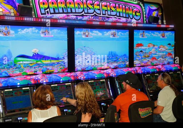 Nevada Las Vegas Downtown Plaza Hotel & Casino slot machine machines gambling gamblers man woman - Stock Image