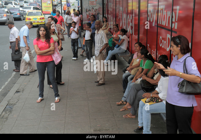 Panama City Panama Bella Vista Via Espana bus stop street scene rush hour bench waiting public transportation Hispanic - Stock Image