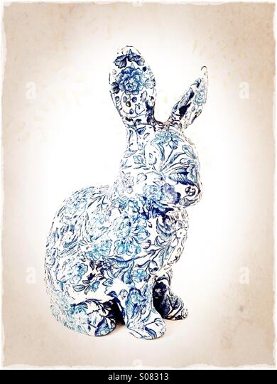 A floral bunny figurine. - Stock Image
